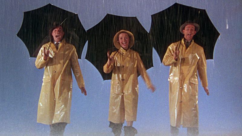Gene Kelly, Debbie Reynolds e Donald O'Connor em cena do filme