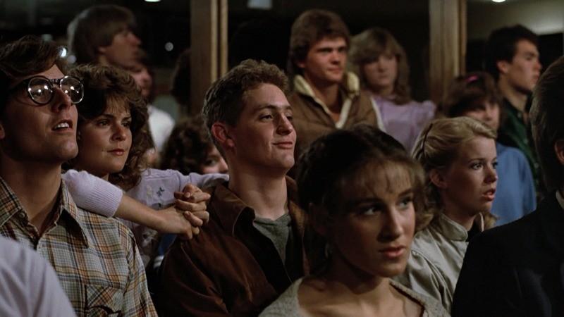 Chris Penn e Sarah Jessica Parker em cena de Footloose