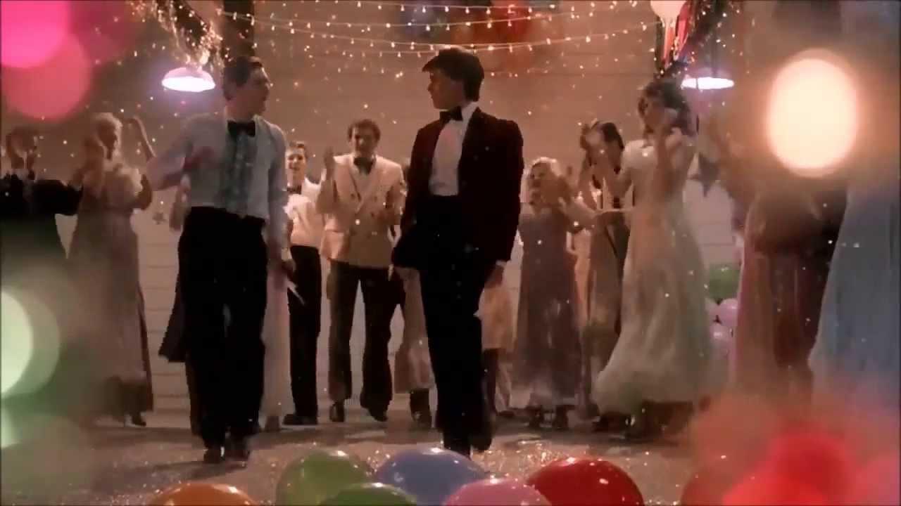 Chris Penn e Kevin Bacon em uma das cenas de dança