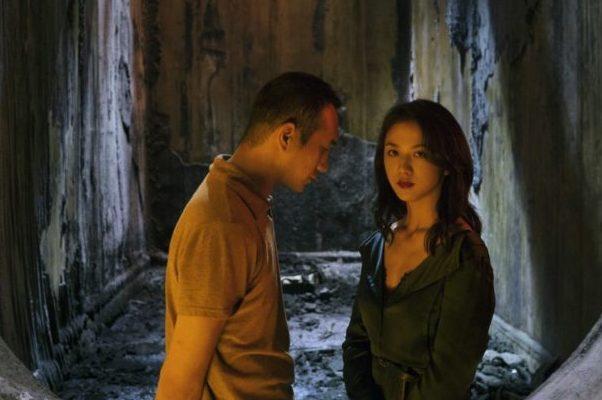 Huang Jue e Tang Wei em cena do filme Longa Jornada Noite Adentro
