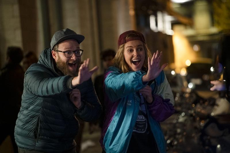 Seth Rogen e Charlize Theron em Casal Improvável